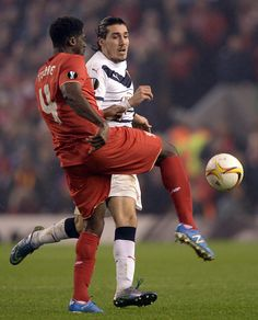 Bordeaux's French forward Enzo Crivelli vies with Liverpool's Ivorian defender Kolo Toure during a UEFA Europa League group B football match between...