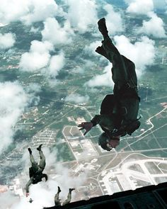 Yigo, Guam, May 2, 2000 — Aircrew Survival Equipmentman 1st Class Mitch MacKenzie of Philadelphia Penn., assigned to Explosive Ordnance Disposal Mobile Unit Five (EODMU-5) free falls from a U.S. Air Force C-130 Hercules during parachute certification training. EODMU-5 is operating in Yigo, Guam, in support of the multi-national, joint forces training exercise, Tri-Crab 2000.