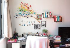 Note the origami on the branch sculpture. The book shelves. Hanging art on clips. Kristiana's Rustic Modern in Montreal
