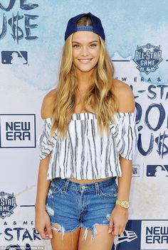 Cute ensemble: The Danish-born beauty wore a pair of ripped daisy dukes and an off the sho...