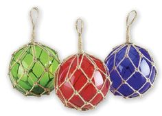"We offer these glass fishing floats in Red, Green or Dark Blue. Each is in knotted jute rope ready for hanging.  Glass Measures: 6"" D"