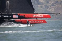 The best images from the race between kiteboarder Kai Lenny and the Oracle Team USA catamaran.