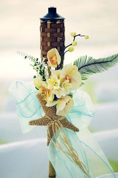 Tiki Torches dressed in style www.abeautifulfloridawedding.com