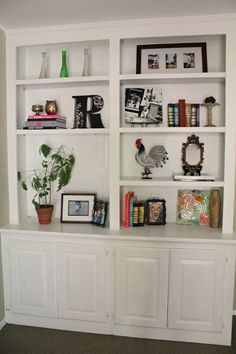 shelves...take down living room/hallway wall. replace with built ...