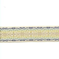 """Width: 2 1/4""""Description:This is a beautiful blue, seafoam, green and tan scroll design tape trim. This trim will add that special touch to any pillow or drape.v001HEF"""