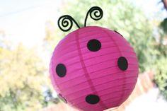 Ladybug lanterns - pink or red lanterns with black circles and black pipe cleaner antennae