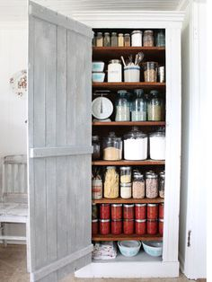 """Pantry - """"Repurpose an antique cabinet and paint the inside of the door your favorite color."""""""
