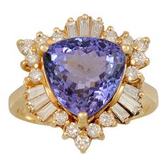 Tanzanite Diamond Gold Ring | From a unique collection of vintage fashion rings at http://www.1stdibs.com/jewelry/rings/fashion-rings/