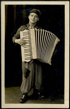 Fab photo. Love the lighting; love the trousers and love the accordion