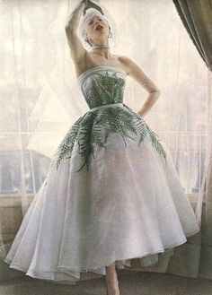 Vogue 1950    Bettina is wearing an evening gown with a fern leaf motif, by Jacques Fath