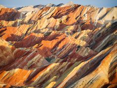 Danxia, China. Visitors stand on an incomplete footpath at a geological park being developed for tourism Photograph: Amos Chapple