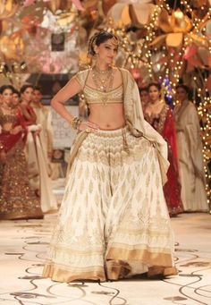 Rohit Bal's blend of ivory and antique gold on this white lehenga is apt for a trendy bride.