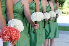 Kinda like the simplicity of the white carnation bouquets for my girls. Maybe with some rhinestones and bear grass...