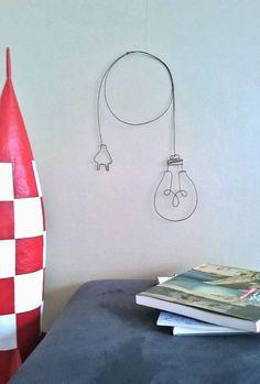 Baladeuse , decoration murale en fil de fer