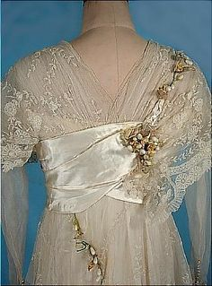 "A detailed photo of the bodice back of the ca. 1913 wedding gown. This dress was sold some time ago on ""Antiquedress.com"", but she has left the photos in her ""Museum"" section for study and display. I suspect this dress, with its gorgeous laces and silk satin, probably sold for several thousand dollars, as it looks to be in decent condition."