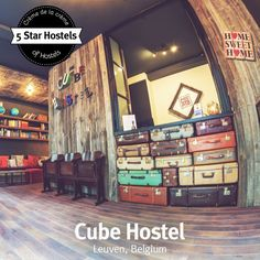 This is the fabulous reception desk of the 5 Star Hostel Cube Hostel in Leuven, Belgium! It is made out of suitcases as you can see - rocks, right?! Read more about their 5 stars at http://hostelgeeks.com/5-star-hostel-leuven-cube-hostel/ #5StarHostels
