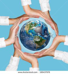 Hands holding the earth, blue background. Elements of this image furnished by NASA. - stock photo