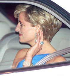 Princess Diana wearing her aquamarine ring - Prince Harry gave it to Meghan as a wedding gift.