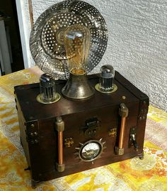 """http://elosworldofeverthingelse.blogspot.de/2017/03/lady-adas-mad-lamp.html (My own blog) Lamp with some special """"Steampunk"""" functions. Like simulation of burning fire, flickering light, soft light start to simulate the rising of the steam pressure. Synchronized meter and some more gimicks."""