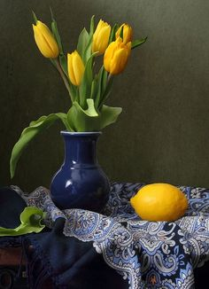Still life image | Yellow tulips in vase | lemon | Blue