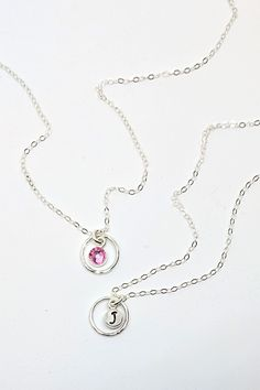 Reversible October birthstone & initial necklace with a karma circle