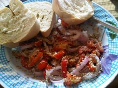 Ghana Michael's breakfast consisting of chopped fresh tomatoes, onions , bread and sprinkled with sesame seeds.