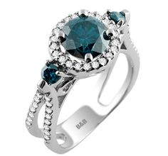 Be Enchanted by this Gorgeous Blue and White Diamond Ring with Shimmering Halo and Split Shank Design in 14k White Gold.  Beautiful!