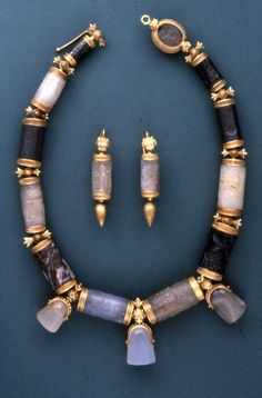 A 19th century jewellery set made from Assyrian and Babylonian cylinder and stamp seals, belonging to Lady Layard. The seals date from anywhere between 2000 and 600 B.C., the gold mounting from the...