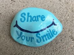 Share Your Smile. Hand painted rock by Caroline.