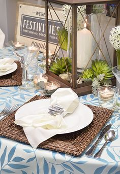 Ideas for a tropical, natural look at your event or wedding. Rattan chargers, palm overlay, ocean-colored base linen, succulents, candlelight. | Design by FestivitiesMN.com