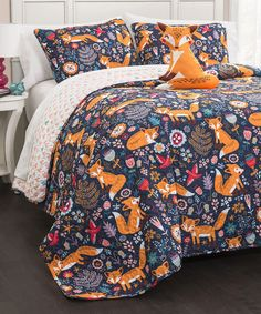 Take a look at this Navy Pixie Fox Quilt Set today!