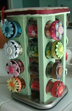 #papercraft #crafting #organization Here's a Spice Rack that's been painted and embellished. Store small crafts such as buttons, brads, clips and embellishments in these cute bottles. Everything is at your fingertips and it spins!
