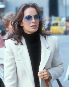 Jaclyn Smith is known just as much for her on-screen prowess as she is for her timeless style. The iconic actress and Charlie's Angel brings out the softer side of menswear in the photo above from 1978—slightly sensual and totally sophisticated. For those looking to add a bit of the on-trend borrowed from the boys…