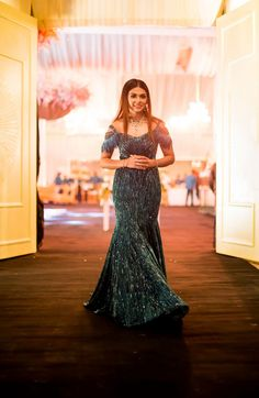 Beautiful faux-feather gown for cocktail party. See more on wedmegood.com  #wedmegood #indianwedding #indianbride #cocktail #gowns #weddingdress #dress