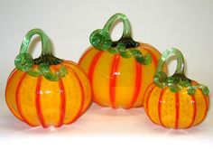 Yellow and Orange Pumpkins by Ken Hanson and Ingrid Hanson. Set of three hand blown glass pumpkins. Set includes one small, one medium and one large blown glass pumpkin. Also sold individually. Glass Pumpkins, Mini Pumpkins, Pumpkin Art, Pumpkin Carving, Small Art, Large Art, Orange, Yellow, Hand Blown Glass