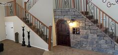 Under the stair wasted storage space remodeled to be a fully functional child play room complete with reading nook, book shelves, cable television and a rear entry door into the living area. www.twdaz.com #twdaz #playroom #wastedspaceunderstairs
