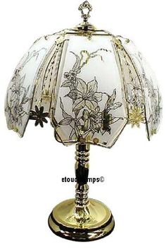 Chandelier table lamps a collection by elizabeth john favorave morning glory touch lamp with polished brass base the lamp is 23 inches tall the diameter of the lamp shade is 14 inches the lamp uses watt bulbs which aloadofball Image collections