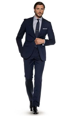 The navy blue mohair Perry suit is cut on our Sackville slim fit block which offers a more contemporary look.The 2-button jacket is more fitted at the waist, has a narrower lapel and lower buttoning. It boasts a felt fabric 'melton' under the collar, that creates a smooth curve and sits properly; and the floating chest piece ensures the jacket moulds to your shape.The flat front trousers feature a curtain waistband, french bearer and double hook and bar front fastenings which further…