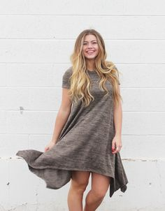 Nothing beats a simple t-shirt dress! We love the drape details at the end that provide interest! $34