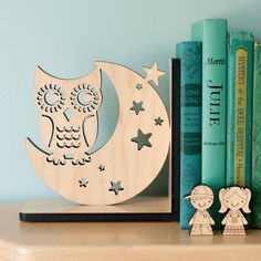 etsy  http://www.etsy.com/listing/82963496/night-owl-wood-bookend-modern-baby?ref=sr_gallery_7&ga_search_submit=&ga_search_query=owl+bookend&ga_view_type=gallery&ga_search_type=handmade&ga_facet=handmade