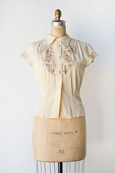 Elegantly lovely 1940s cream rayon blouse with tone-on-tone embroidery.