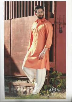 Give an Elegant look by wearing this Orange Colour Pathani Suit in this Eid Festival.