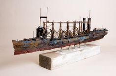 Self-taught artist John Taylor uses various discarded materials to create imperfect models of sea vessels