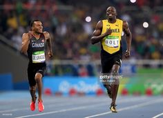 Andre de Grasse of Canada (L) and Usain Bolt of Jamaica react as they compete in the Men's 200m Semifinals on Day 12 of the Rio 2016 Olympic Games at the Olympic Stadium on August 17, 2016 in Rio de Janeiro, Brazil.