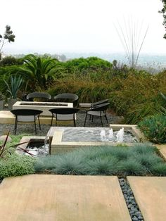Relief under fire pit and contemporary water feature
