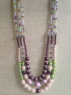 Items similar to Purple, green, pink and light blue pearls multi-strand necklace set. on Etsy Blue Pearl, Purple, Pink, Light Blue, My Etsy Shop, Beaded Necklace, Pearls, Trending Outfits, Unique Jewelry