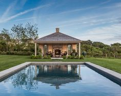 Nantucket Home with New Coastal Interiors. This poolhouse was beautifully designed with an outdoor fireplace. Nantucket Style Homes, Nantucket Home, Kitchenette, Guest House Cottage, Pool House Designs, Outdoor Kitchen Design, Outdoor Kitchens, Luxury Kitchens, Beautiful Pools