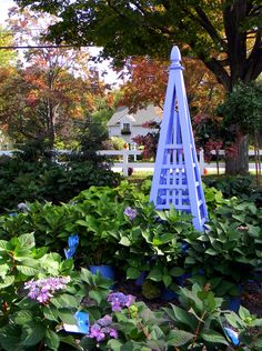 "6' garden obelisk, painted in ""hydrangea"" from artisansheds.com"