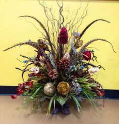 Dried arrangement with feathers by Arcadia Floral & Home Decor