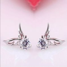 Silver fashion angel wings crystal earrings New New🌟silver CRYSTAL RHINESTONE ANGEL WING earrings. New w pkg. these are lovely earrings two pairs available for purchase. Jewelry Earrings